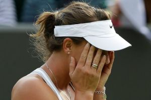 Michelle Larcher De Brito of Portugal reacts after beating Maria Shar